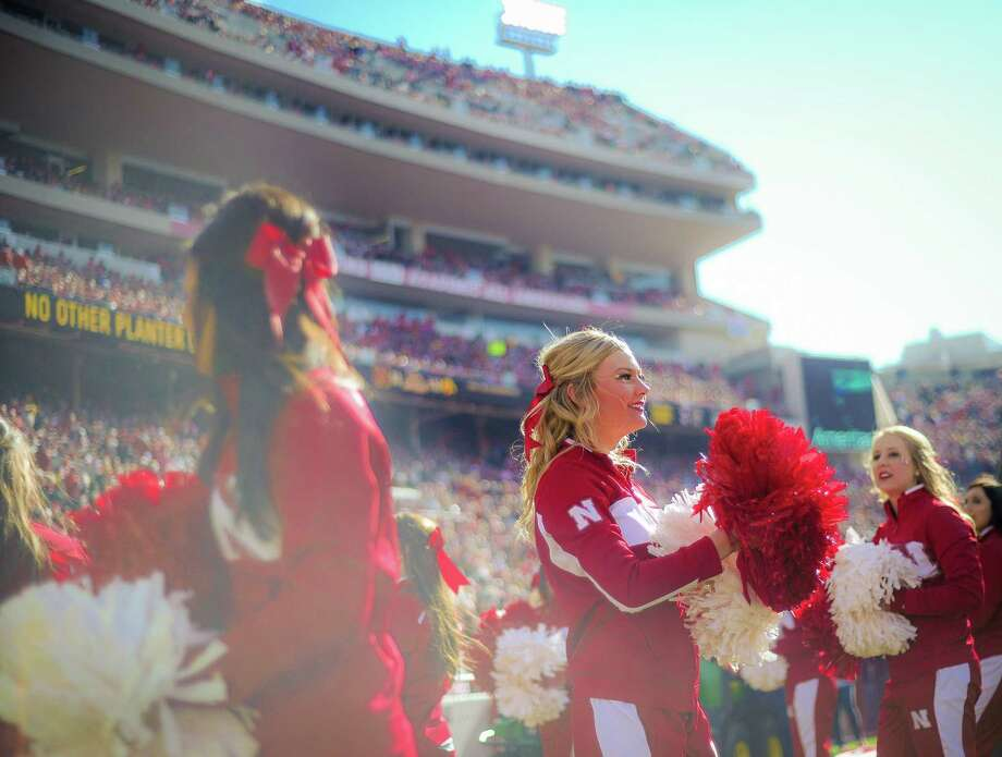 The Nebraska Cornhuskers cheerleaders during their game against the Iowa Hawkeyes at Memorial stadium on November 29, 2013 in Lincoln, Nebraska.  Photo: Eric Francis, Katie Dowd / 2013 Getty Images