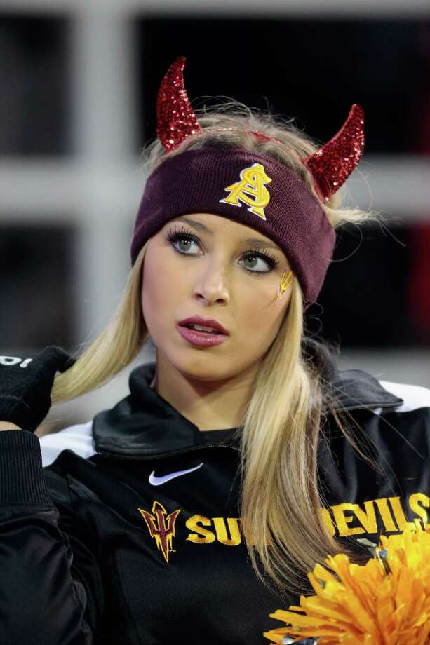 An Arizona State Sun Devils cheerleader looks on during the game.  Photo: William Mancebo, Katie Dowd / 2013 Getty Images