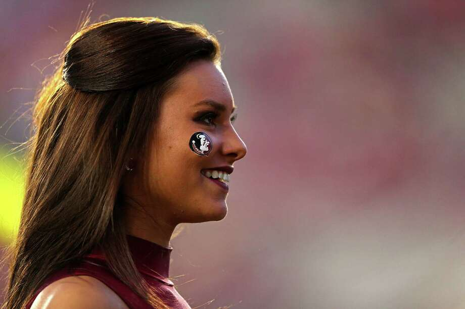 A  Florida State Seminoles cheerleader looks on during a game against the Miami Hurricanes at Doak Campbell Stadium on November 2, 2013 in Tallahassee, Florida. Photo: Mike Ehrmann, Katie Dowd / 2013 Getty Images