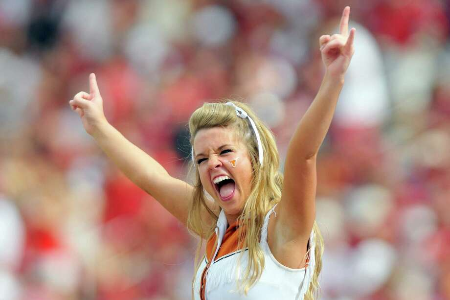 A cheerleader of the Texas Longhorns cheers her team on during their win against the Oklahoma Sooners on October 12, 2013 at The Cotton Bowl in Dallas, Texas.  Photo: Jackson Laizure, Katie Dowd / 2013 Jackson Laizure