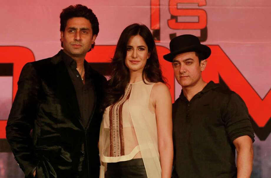 Bollywood actors Aamir Khan right , along with Katrina Kaif center, and Abhishek Bachchan pose for the picture during a news conference of their film Dhoom 3 in Mumbai, India, Tuesday, Dec 10, 2013. Dhoom 3 is a Hindu action thriller film that will be released on Dec. 20. (AP Photo/Rafiq Maqbool) ORG XMIT: RMX101 Photo: Rafiq Maqbool / AP