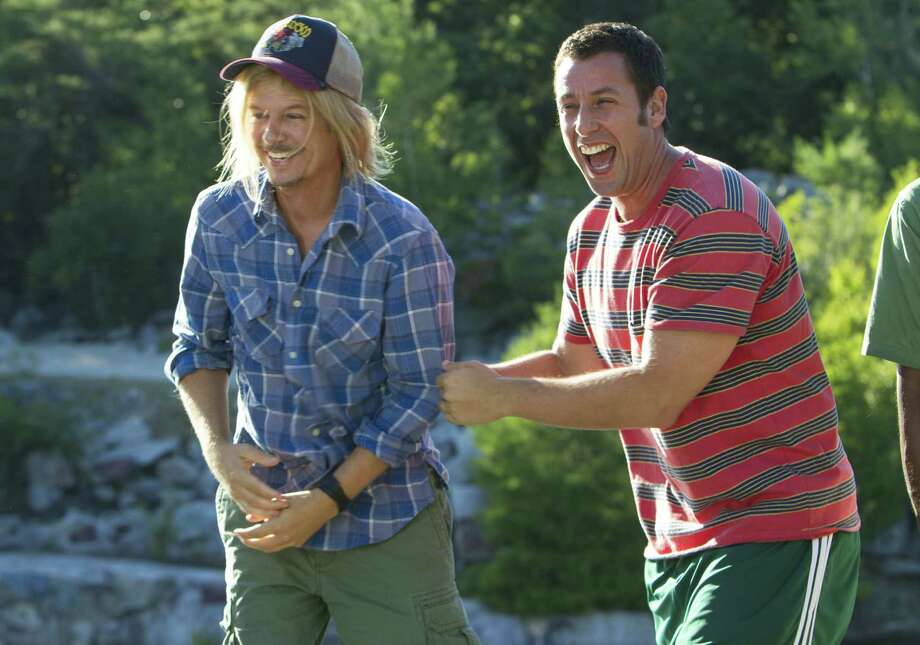 "Critics panned Adam Sandler's ""Grown Ups 2,"" but the film, which also starred David Spade (left), earned $200 million. Photo: Columbia Pictures / © 2013 CTMG, Inc. All Rights Reserved.**ALL IMAGES ARE PROPERTY OF SONY PICTURES ENTERTAINMENT INC. FOR PROMOTIONAL USE ONLY."