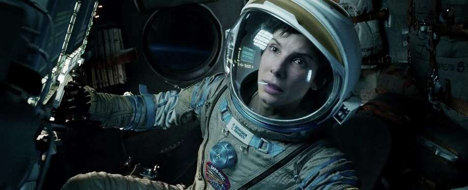 "Catch up on all those Oscar-nominated movies including Sandra Bullock in ""Gravity."" Photo: Warner Bros. / Warner Bros. Pictures"