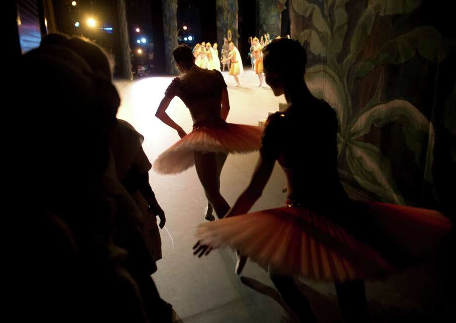 "Dancers of the Bolshoi Ballet enter the stage during the second act of a performance of ""La Bayadere"" at the Bolshoi Theater in Moscow, Jan. 27, 2013. Detectives have been interviewing their way through the ranks of the Bolshoi Ballet for over a week, ever since a masked assailant threw a jar of acid into the face of Sergei Filin, the company's artistic director. (James Hill/The New York Times) --NO SALES. -- Photo: JAMES HILL / NYTNS"
