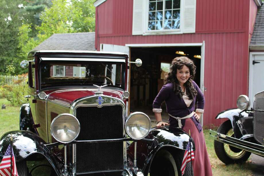 Kristina Thompson, who played Mabel Normand in Rudy Cecera's short fiolm, poses with one of Ron Heinbaugh's cars in his back yard. The cars were featured in Cecera's film. Photo: Contributed Photo, Contributed / Darien News Contributed
