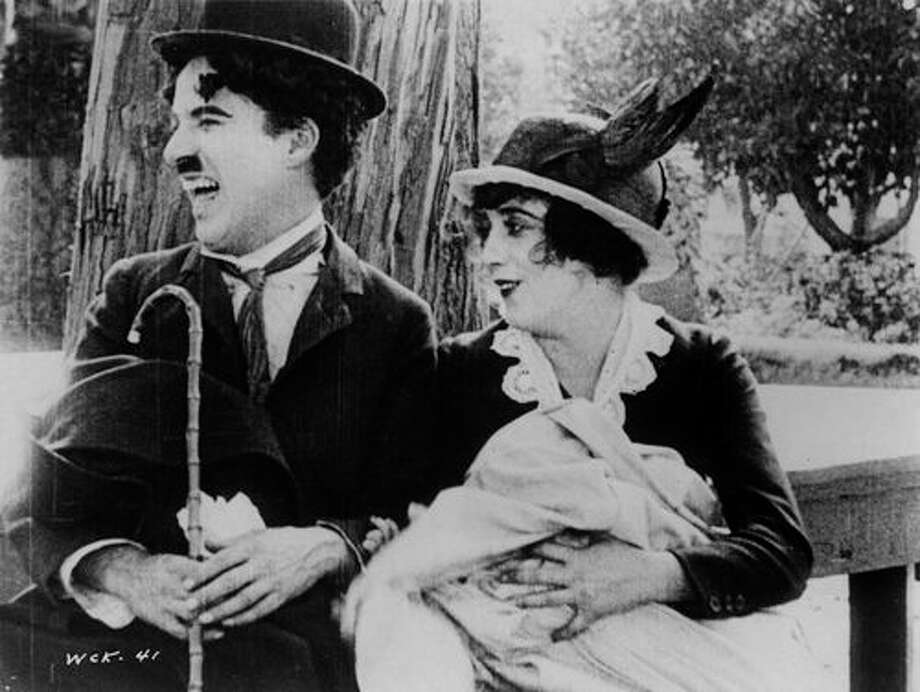What was happening in American in 1914?See how we lived a century ago.It was 100 years ago that Charlie Chaplin starred in 'The Tramp,' one of his most memorable roles.  Take a look back at what life looked like back in 1914. Photo: Picasa, Contributed / Darien News Contributed