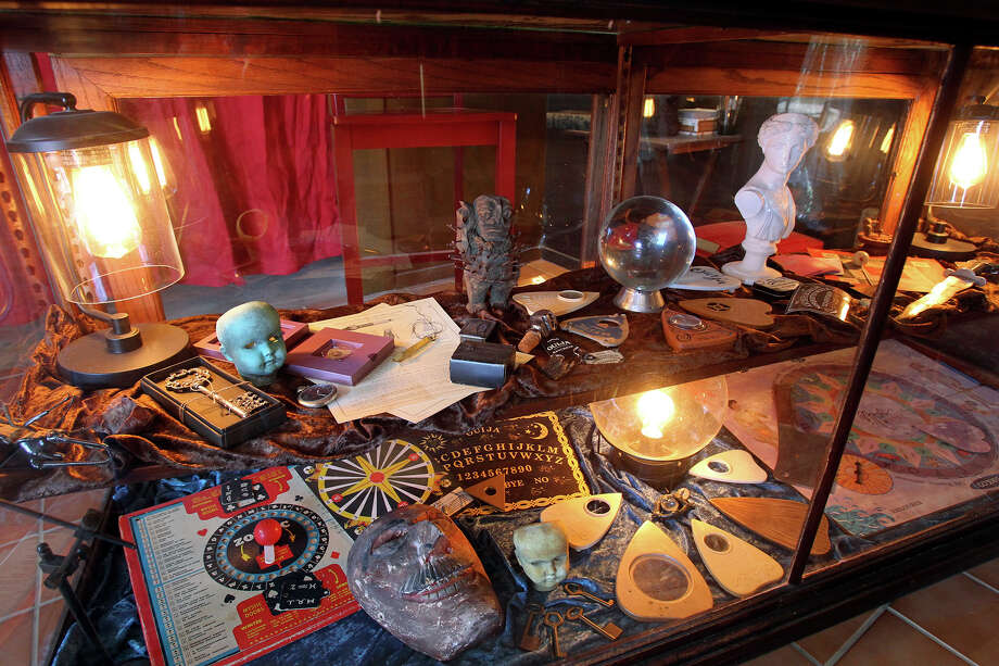 Ouija board artifacts are shown in a display case at Gordon Wiseman's museum. Photo: Tom Reel, San Antonio Express-News / San Antonio Express-News
