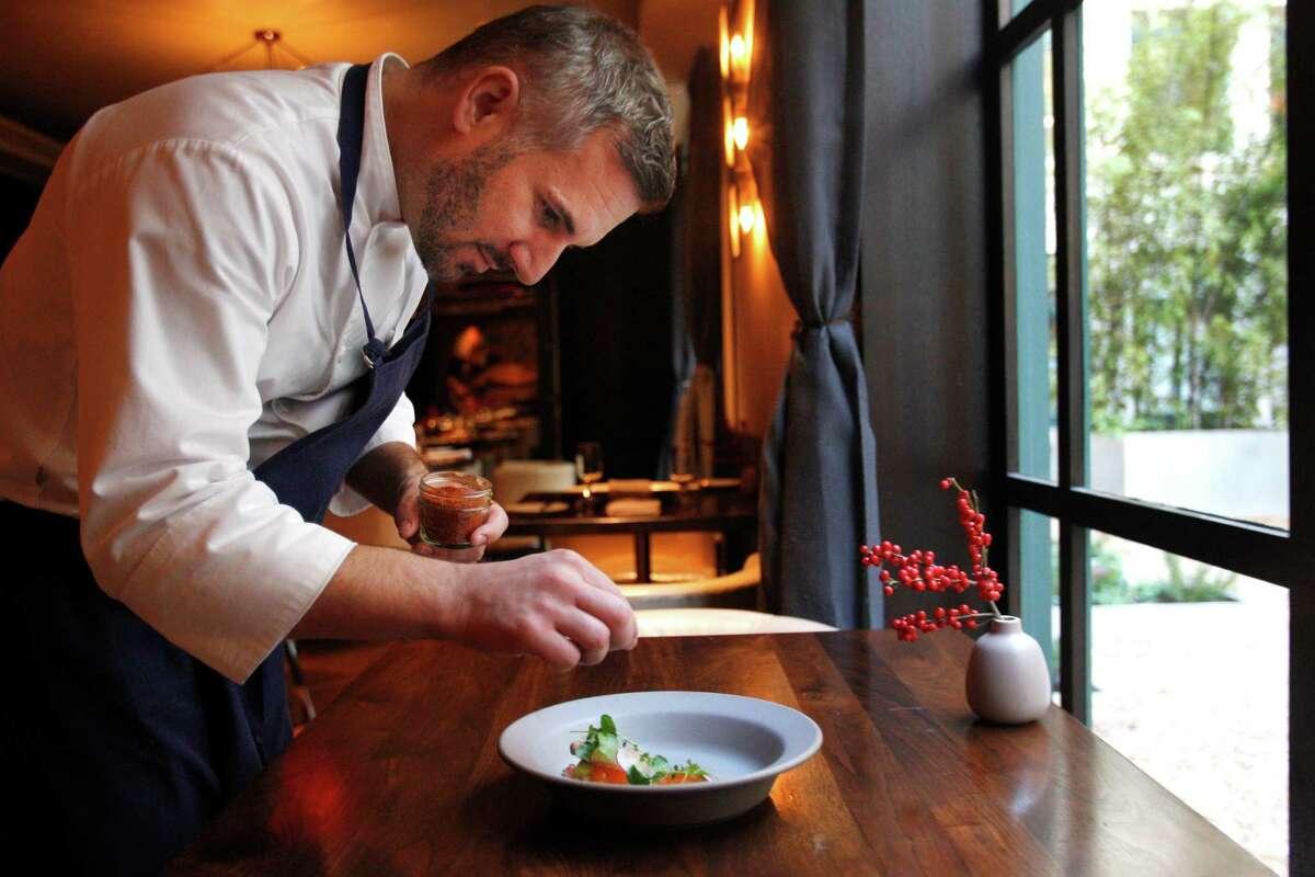 San Francisco chef David Bazirgan sprinkles Aleppo pepper on a Dungeness crab with avocado, urfa chili, Meyer lemon and mandarins.