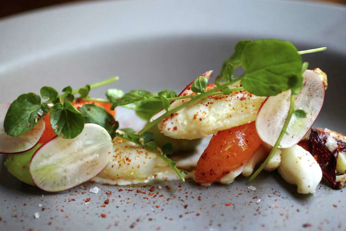 Aleppo pepper on a Dungeness crab with avocado, urfa chili, Meyer lemon and mandarin oranges.