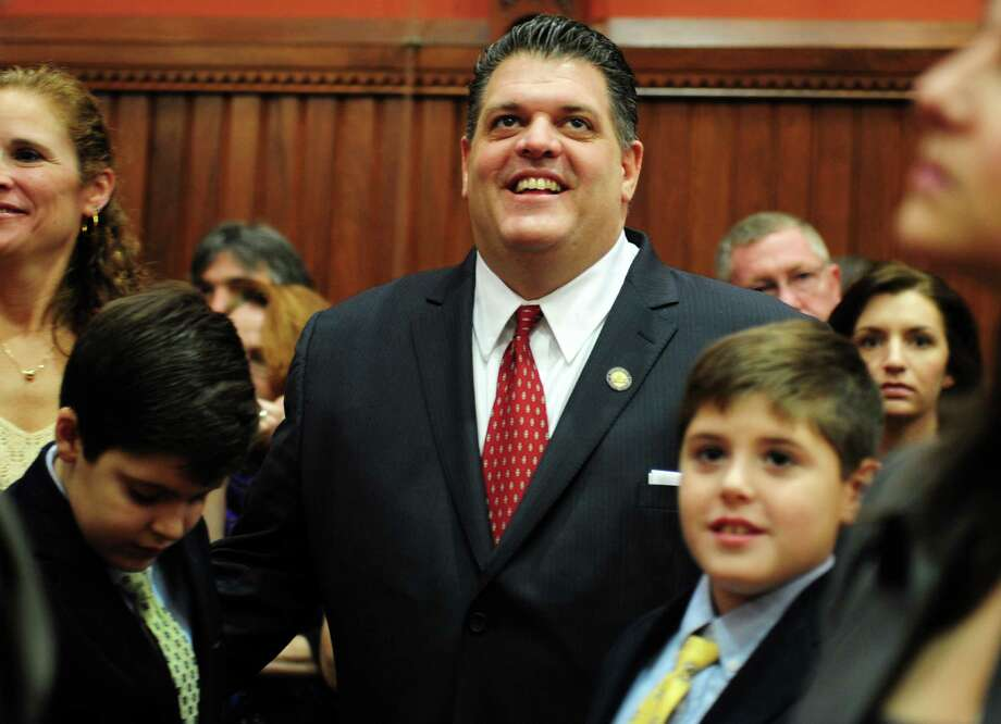 State Rep. David Rutigliano (D-Trumbull) stands with his two sons Wednesday, Jan. 9, 2013 during opening day of the State Legislature at the Capitol Building in Hartford, Conn. Photo: Autumn Driscoll / Connecticut Post