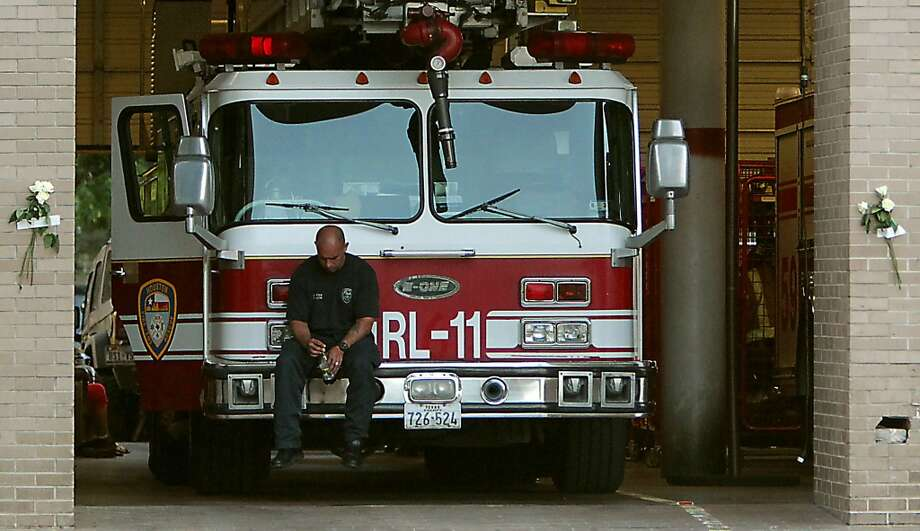A Houston Fire Department firefighter sits on a ladder truck inside Station 68 after several firefighters died fighting a five alarm fire at a restaurant fire, outside HFD Station 68 Friday, May 31, 2013, in Houston. Photo: James Nielsen, Houston Chronicle