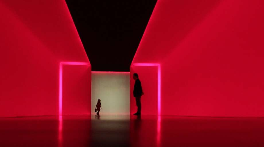 "Visitors walk within ""The Light Inside"" tunnel by James Turrell at the Museum of Fine Arts, Houston Tuesday, March 19, 2013, in Houston.  Photo: James Nielsen, Houston Chronicle"