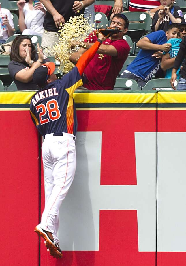 Houston Astros right fielder Rick Ankiel (28) leaps in vain for a home run ball hit by Cleveland Indians right fielder Drew Stubbs during the sixth inning of a major league baseball game at Minute Maid Park Sunday, April 21, 2013, in Houston. Photo: Brett Coomer, Chronicle