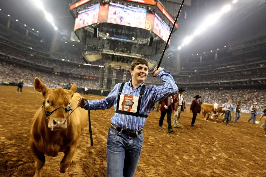 Kelton Long, of Wellington, waves to Stetson Copus, as he reacts after winning the Grand Champion Steer of the Show with his steer at the Houston Livestock Show and Rodeo Friday, March 15, 2013, in Houston. Photo: Houston Chronicle