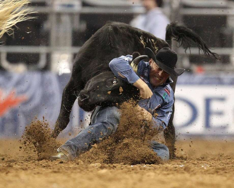 K.C. Jones wrestles a steer to win the Steer Wrestling competition during the final BP Super Series Championship at the Houston Livestock Show and Rodeo Saturday, March 16, 2013, in Houston. Photo: Houston Chronicle
