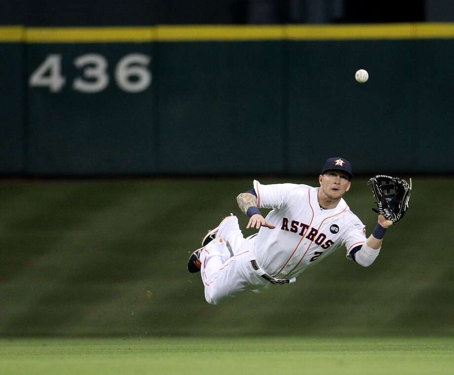 Houston Astros center fielder Brandon Barnes (2) dives to catch a fly out hit by Baltimore Orioles third baseman Manny Machado (13) during the fifth inning of an MLB game at Minute Maid Park, Tuesday, June 4, 2013, in Houston. Photo: Houston Chronicle