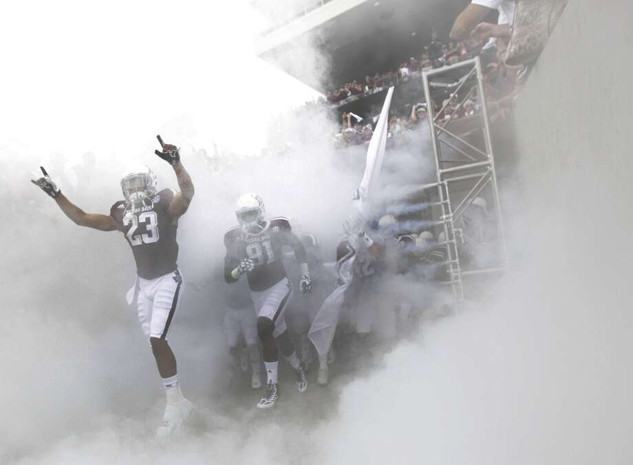 Texas A&M Aggies wide receiver Sabian Holmes and the rest of the team come out of the tunnel before the start of a college football game at Kyle Stadium, Saturday, Sept. 14, 2013, in College Station. Photo: Houston Chronicle