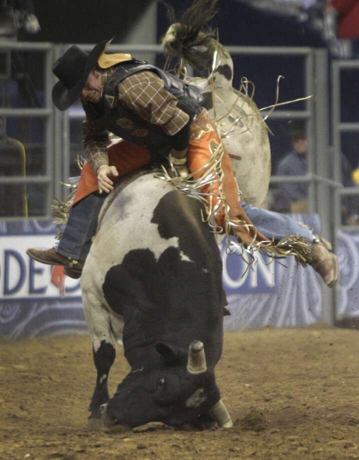 Bryan Richardson of McKinney tries to stay on a bull named Voodoo Daddy but is bucked off during round 1 of the Super Series II  of RodeoHouston at at the Houston Livestock Show and Rodeo at Reliant Stadium Thursday, Feb. 28, 2013, in Houston. ( Melissa Phillip / Houston Chronicle ) Photo: Houston Chronicle