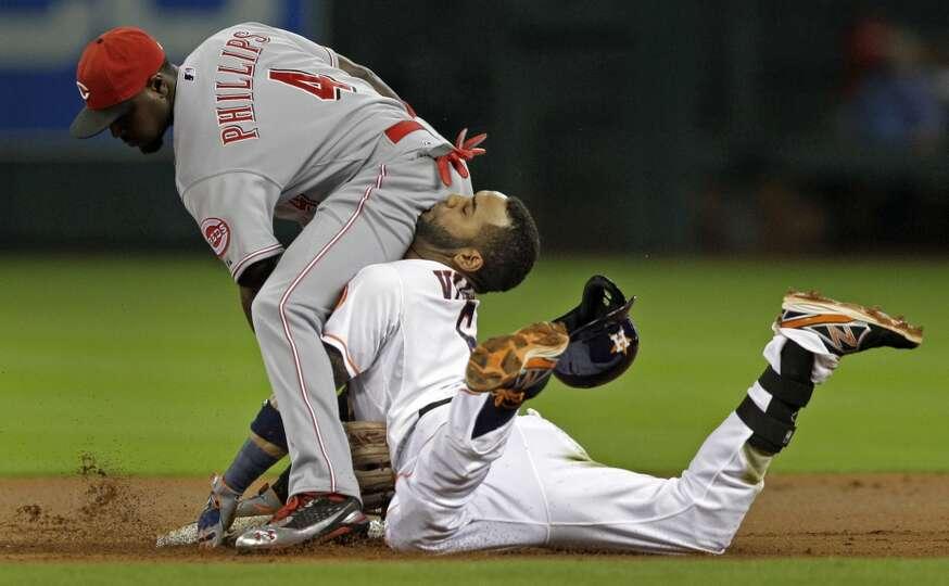 Houston Astros shortstop Jonathan Villar is out at second base against Cincinnati Reds second basema