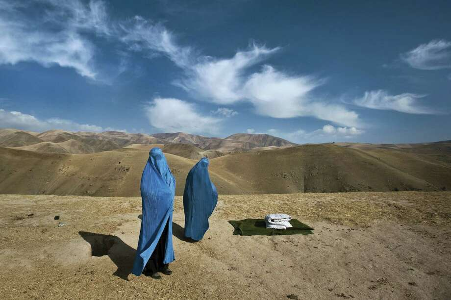 In this photo by Lynsey Addario, Noor Nisa and her mother, Nazar Begam, wait for transport to a hospital four hours away, because Noor Nisa is pregnant and her water has broken but her husband's car has broken down on the way to the hospital. This photo will be in an exhibit of Addario's work opening Jan. 24 at the Westport Arts Center. Photo: Contributed Photo / Westport News