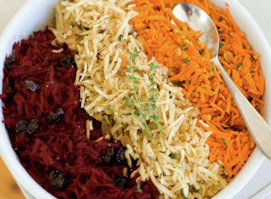 This Nov. 18, 2013 photo shows, from left, shredded beets with balsamic, shredded parsnips with walnuts, and shredded spicy carrots, in Concord, N.H. (AP Photo/Matthew Mead) ORG XMIT: MER2013123013544741 Photo: Matthew Mead / FR170582 AP