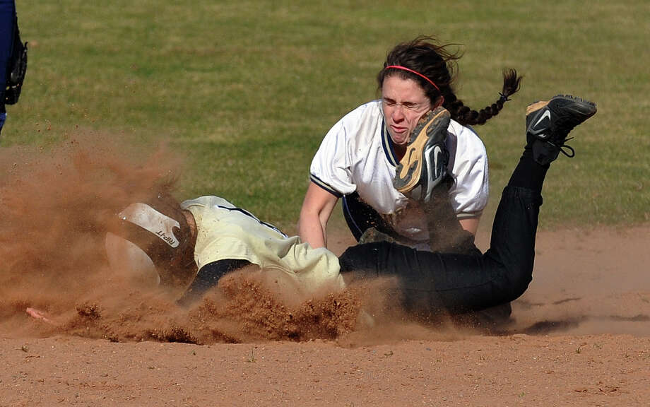 Lauralton Hall shortstop Maureen Connolly attempts to tag out Trumbull's Christie Costello as she dives head first into second base, during softball action in Milford, Conn. on Wednesday April 3, 2013. Photo: Christian Abraham / Connecticut Post