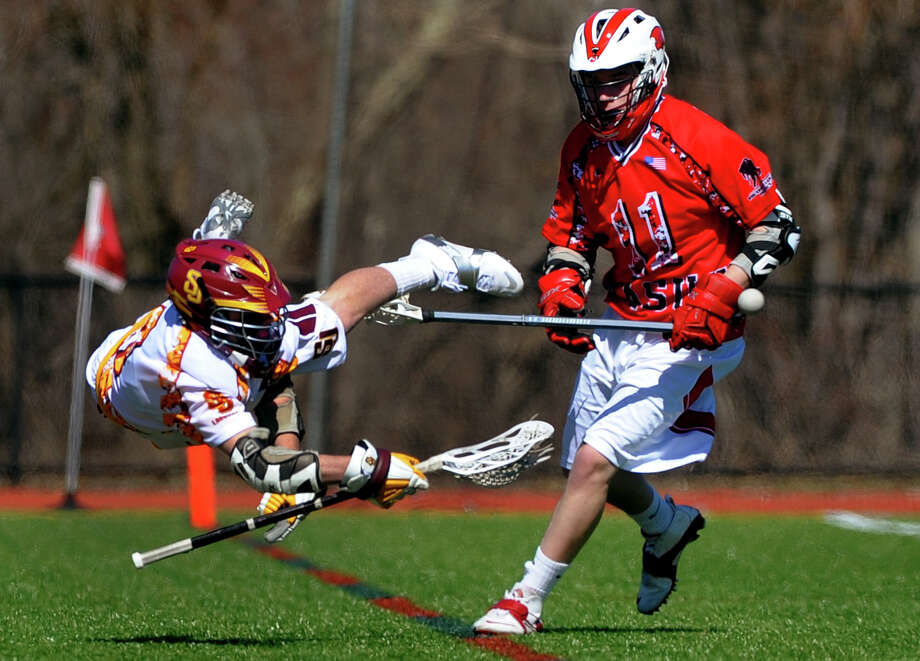 St. Joseph's Ryan Mulligan takes a spill after a push by Masuk's Cody Ryan, during boys lacrosse action in Trumbulll, Conn. on Saturday April 6, 2013. Photo: Christian Abraham / Connecticut Post
