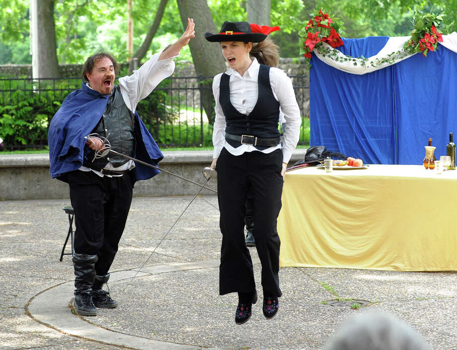 Actors Jon Ciccarelli, left, as Cyrano, and Eleah Burman, as Rageneau, perform during a performance of Shakespeare's Cyrano de Bergerac by the Hudson Shakespeare Company, held at the Stratford Public Library in Stratford, Conn. on Saturday June 29, 2013. This is the 22nd season of the traveling summer theater. Upcoming shows in July and August will be Henry VIII and Macbeth. More information can be found at: www.hudsonshakespeare.homestead.com Photo: Christian Abraham / Connecticut Post
