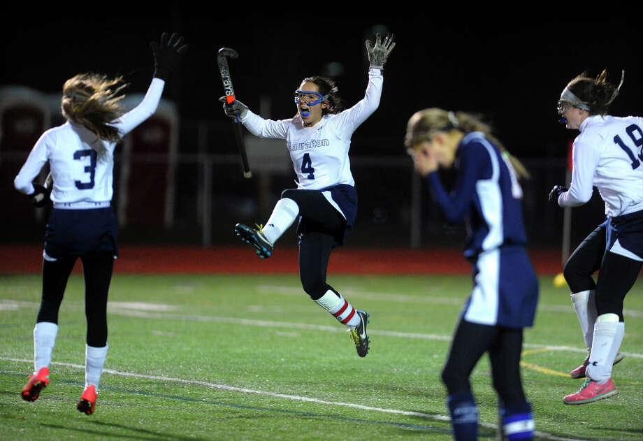 Lauralton Hall's Elizabeth Lamonte leaps into the air to celebrate after getting a goal in overtime to beat Avon, during CIAC Class M field hockey semifinal action in Watertown, Conn. on Tuesday November 12, 2013. Photo: Christian Abraham / Connecticut Post