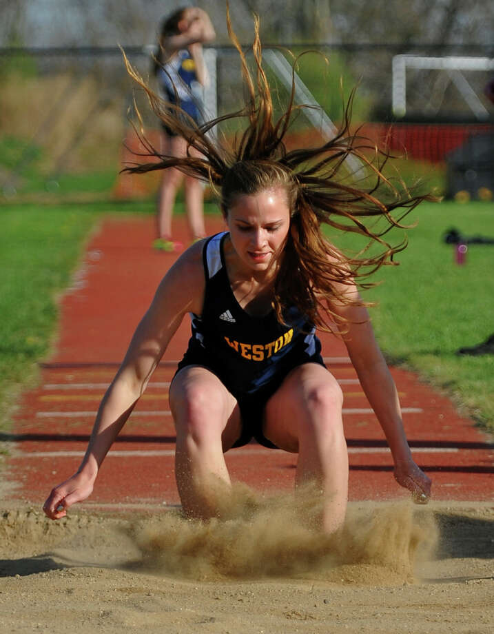 Weston's Sara Dietzman competes in the triple jump event, during track action at Barlow High in Redding, Conn. on Tuesday April 30, 2013. Also competing were Immaculate and Masuk. Photo: Christian Abraham / Connecticut Post