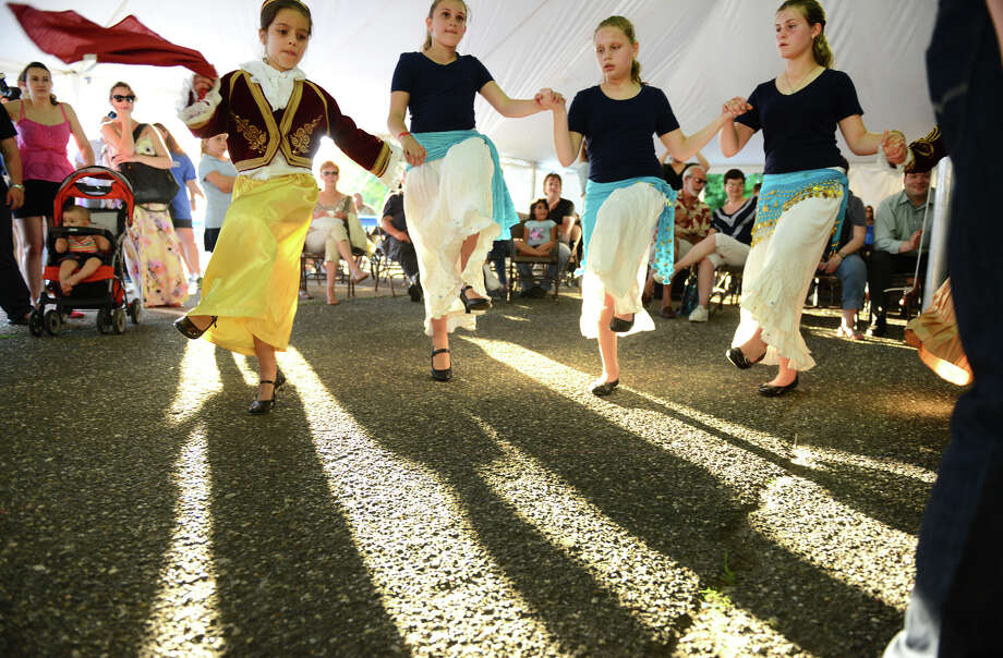 A traditional Greek dance called the Tsamiko dance, is performed by children during Holy Trinity Greek Orthodox Church's Olympiad 2013 Greek Festival and Fair on Friday May 31, 2013. From left to right is Neklana Karagianni, Angelica Vlamis, Gabriella Papannikolacu, and Eleni Panagiotidis. The festival continues on Saturday June 1 from 11 AM to 11 PM and on Sunday June 2 from 11 AM to 9:30 PM. Photo: Christian Abraham / Connecticut Post
