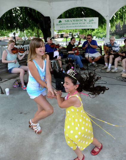 Alexandra Baghdady, 10, and her friend Kaitlin Braz,5, dance to the music of Irish band Shamrogues a