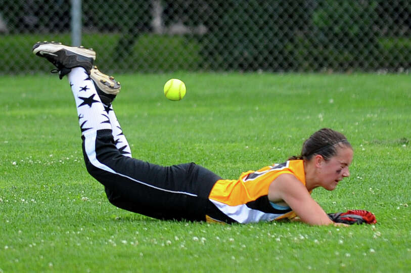 Trumbull's Kristen Pagliaro misses a Fairfield pop fly, during little league softball championship a