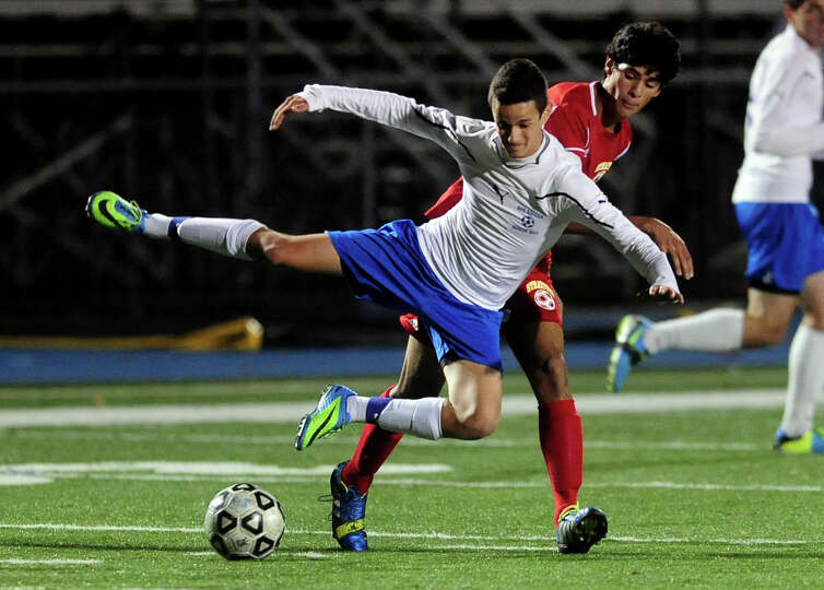 Bunnell's Christopher Nava goes airborne after tripping over Stratford's Nelson Duque, during boys h
