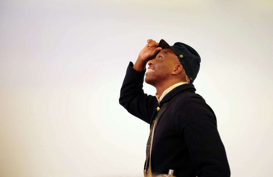 """Kevin Johnson, from the Connecticut State Library, portrays Pvt. William Webb, an African-American Civil War soldier from the 29th Connecticut Volunteers, Saturday, Jan. 19, 2013 during a presentation at the Fairfield Museum and History Center.  Johnson's one-man show, Living History: The Life and Times of William Webb, is part of the center's """"Promise of Freedom: The Emancipation Proclamation"""" exhibition which runs through Feb. 24, 2013. Photo: Autumn Driscoll / Connecticut Post"""
