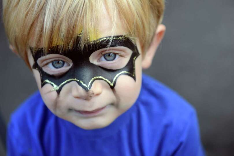 Graham Rogers, 2, of Wilton, has his face painted like batman during the 38th annual SoNo Arts Celeb