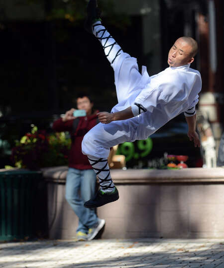 A member of the Ringling Bros. and Barnum & Bailey Shaolin Kung Fu Warriors performs at McLevy Green