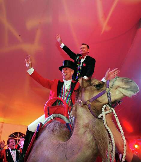 2013 Barnum festival Ringmaster John Stafstrom and husband Dennis Murphy make a grand entrance at th