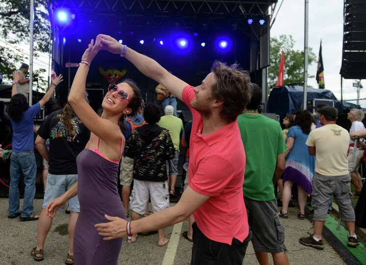 Kera Pesall and Trevor Cape, of Toronto, Ontario, Canada, dance together as David Gans performs on t