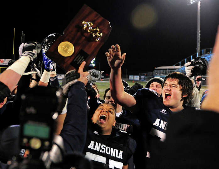Ansonia celebrates its win over Woodland 51-12 after Class S football championship action at Central