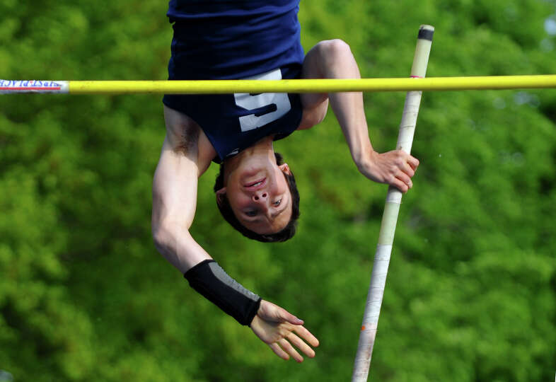 Staples Alex Lochoff competes in the pole vault event, during track action against Fairfield Warde a