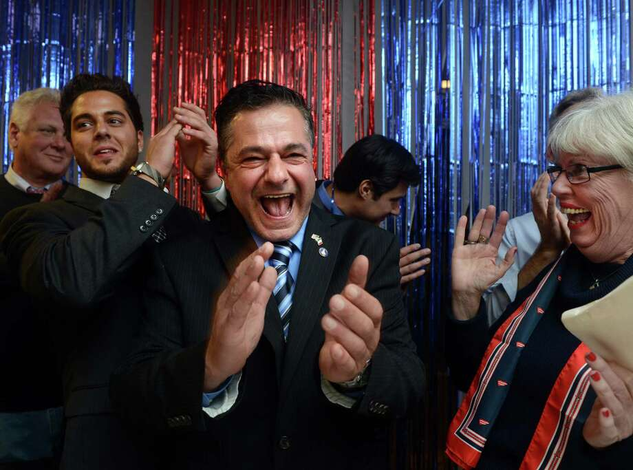 Republican David Cassetti, with his son Anthony left, a newly elected Alderman, and newly elected treasurer Judy Larkin Nicolari, right, celebrates his win over incumbent Mayor James Della Volpe Tuesday, Nov. 5, 2013 at Republican Headquarters in Ansonia, Conn. Photo: Autumn Driscoll / Connecticut Post
