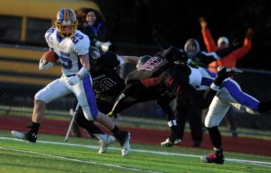 Brookfield's Gabe Pompette scores a touchdown during the Class M seminfinal football game against Valley Regional Saturday, Dec. 7, 2013 at Cheshire High School in Cheshire, Conn. Photo: Autumn Driscoll / Connecticut Post