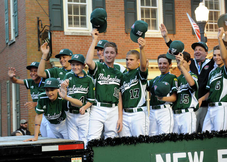 Kids on the Westport team, now called New England for the Little League World Series, wave to family