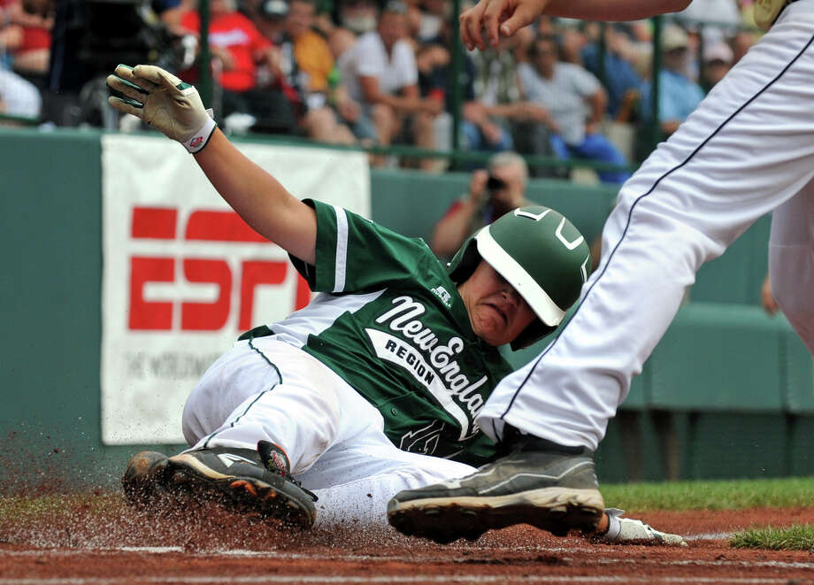 Westport's Charlie Roof slides safely into home plate to score, during Little League World Series action against Northwest in Williamsport, Pa. on Sunday August 18, 2013. Westport beat Northwest 9-7. Photo: Christian Abraham / Connecticut Post contributed