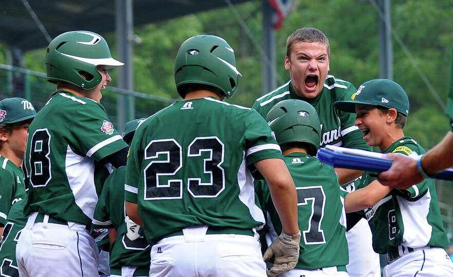 Westport's Charlie Roof reacts as Chad Knight lands at home plate after hitting a home run, during L
