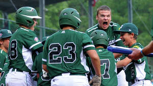 Westport's Charlie Roof reacts as Chad Knight lands at home plate after hitting a home run, during Little League World Series action against Sammamish, Wash. in Williamsport, Pa. on Saturday August 23, 2013.