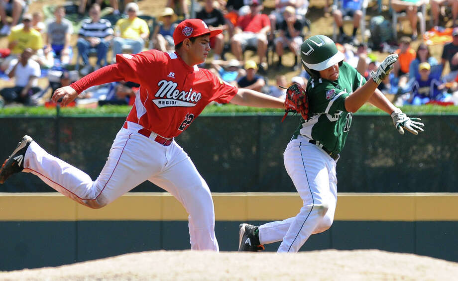 Mexico's Miguel Artalejo tags out Westport's Charlie Roof as he tries to get back to second, during Little League World Series action in Williamsport, Pa. on Sunday August 25, 2013. Mexico beat Westport 15-14. Photo: Christian Abraham / Connecticut Post contributed