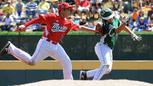 Mexico's Miguel Artalejo tags out Westport's Charlie Roof as he tries to get back to second, during Little League World Series action in Williamsport, Pa. on Sunday August 25, 2013. Mexico beat Westport 15-14.