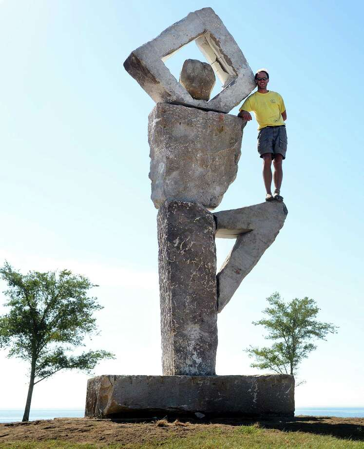 Artist Ethan Currier, a Connecticut native, has completed an 18-foot-tall sculpture of a stone mother in a tree pose at Seaside Park in Bridgeport, Conn.  The granite sculpture weighs in excess of 15,000 lbs. Photo: Autumn Driscoll / Connecticut Post